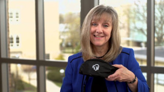 Stillman School of Business Dean Joyce Strawser with the Rise to the Challenge fanny pack.