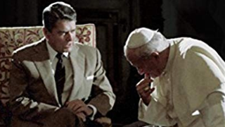 An image of President Ronald Regan and Pope John Paul II seated together.