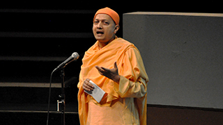Photo of Swami Sarvapriyananda giving a lecture