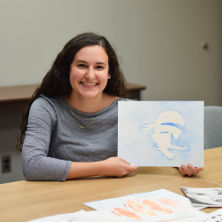 Graduating senior and graphic design major, Paola Hegedus, plans to use her degree as a missionary for St. Paul's Outreach.