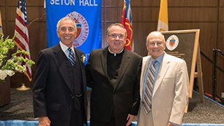 Robert S. Basso '67, Rev. Paul A. Holmes '77 and Nicholas R. Scalera '63 at the dedication of Bethany Hall in June. Basso, Father Holmes and Scalera are brothers in Phi Kappa Theta National Fraternity. x320