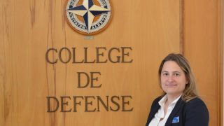 Sara Moller in front of Defense College