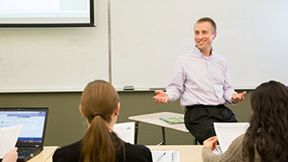 Robert Kelchen at the front of a class, teaching students.