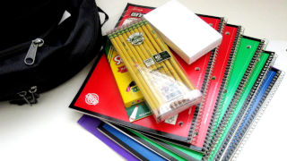 Colored notebooks and pencils