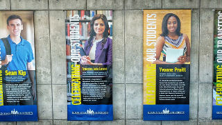 Hanging Banners in Jubilee Hall Highlighting Student Success