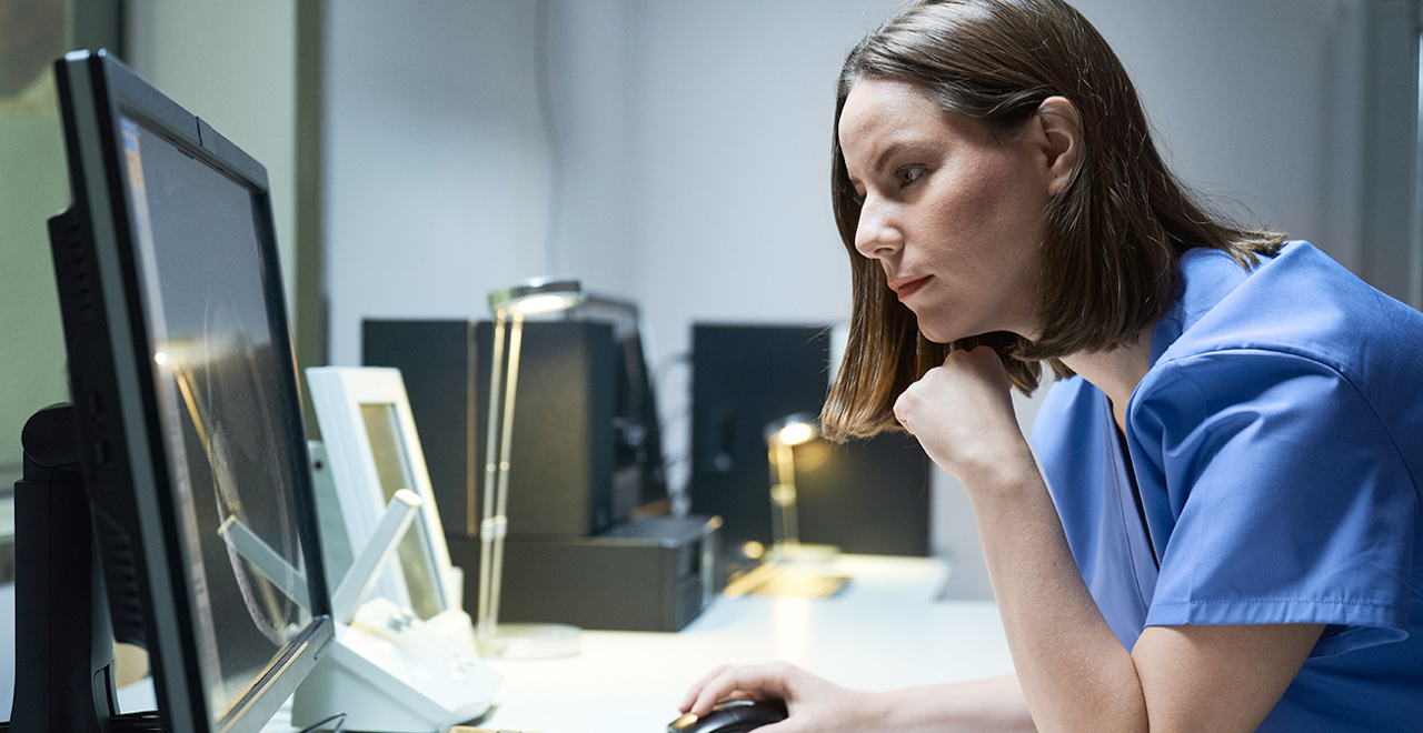 Nursing student working on a computer