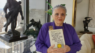 Luna Kaufman with her book