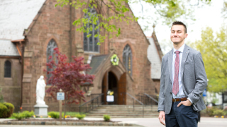 Anthony Tokarz in front of the chapel.